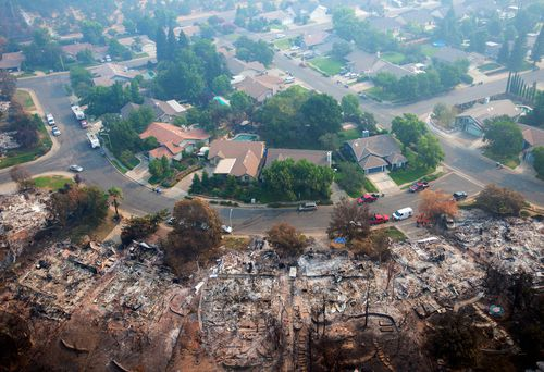 Homes destroyed by a wildfire are seen from an aerial view in the Keswick neighborhood of Redding.
