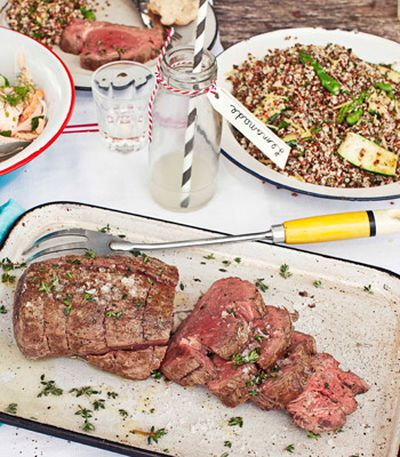 Seared beef fillet with mixed quinoa, chargrilled zucchini, preserved lemon and asparagus salad