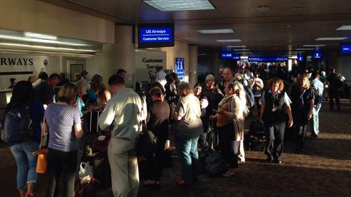 The terminal closure caused long delays for passengers. (@michaelpan)