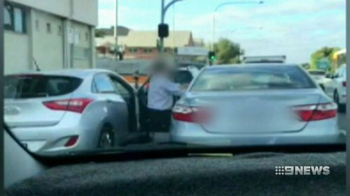 He tried repeatedly to pull his attacker through his passenger side door. (9NEWS)