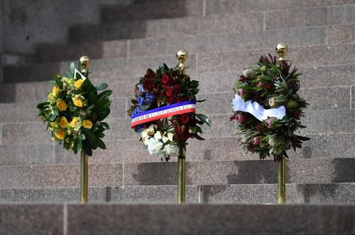 Pride of place: Floral tributes on the steps of the Anzac war memorial. Picture: AAP