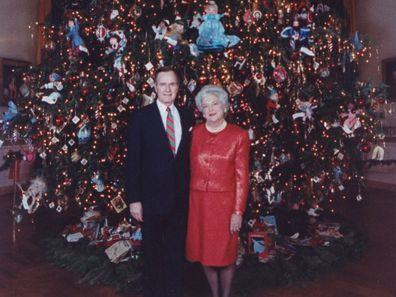 George and Barbara Bush with the White House Christmas Tree in 1989.