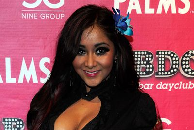 "Nicole 'Snooki' Polizzi hosted a party at the Palms Casino Resort. Sporting a relatively demure look (for her, at least) we like the subtle red streaks in her shiny hair (minus her signature ""pouff"" - thank goodness!)<br/>"