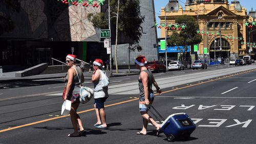 Silly season beachgoers in Melbourne's CBD (Image: AAP)