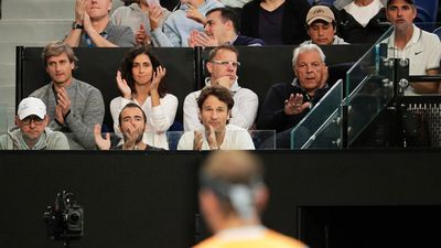 Xisca Perello claps as her partner Rafael Nadal of Spain plays his men's singles third round match.