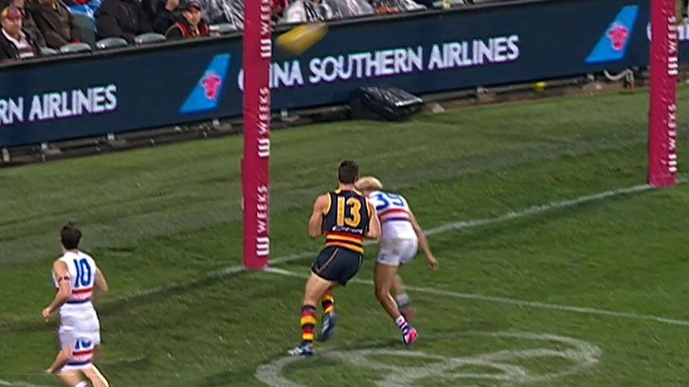 Walker under scrutiny for heavy bump on Johannisen in AFL win over Bulldogs