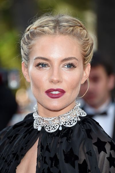 <p>Dewy skin stopped this look from becoming too heavy and helped balance the deep red lip.</p>