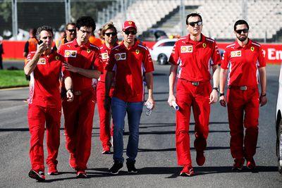 <p>Sebastian Vettel (GER) Ferrari walks the circuit with the team ahead of the Grand Prix. (AAP)</p>