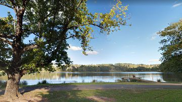 A man's body has been pulled from Lake Conobolas shortly after a swimmer vanished.