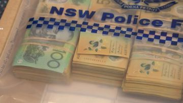 A bag of cash was dumped at Bondi after a failed robbery