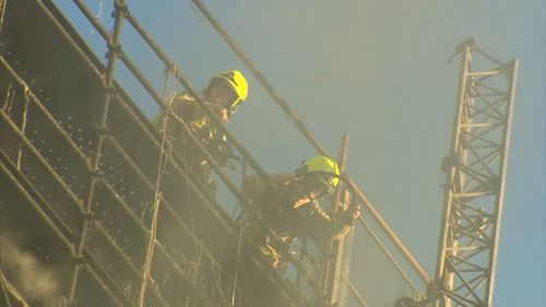 Fire crews are at the building working to extinguish the blaze. Picture: 9NEWS
