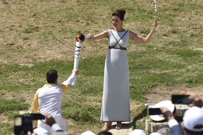 Greek world gymnastics champion Eleftherios Petrounias received the flame as the first torch bearer for the Rio Games.