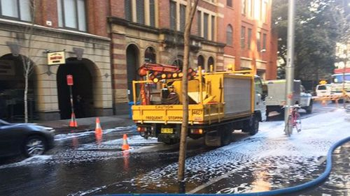 Sydney CBD flooding incident with George and Kent Streets affected. (Triple M Sydney/Twitter)