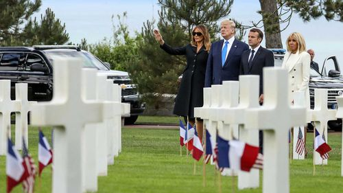 The Trumps and the Macrons visit a cemetery in Normandy.