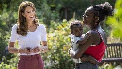Kate Middleton, Duchess of Cambridge meets with MUSH mother and baby group member, Morgan Alex Cassius and her 6 month old, Makena Grace during a visit to Battersea Park, London, Tuesday, Sept. 22, 2020
