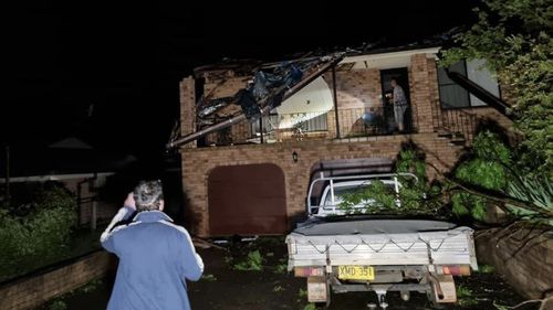 No-one was injured, however rooves were torn off homes, trees were felled and one car was flipped by the whirlwind storm system.