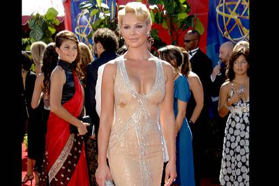 <b>Where she wore it:</b> The 58th Annual Primetime Emmy Awards, 2006.<br/><br/><b>The look:</b> Even without the boob sweat (apparently, it was really hot at the Emmys that year), this isn't a great look... unless you want to resemble a prim Vegas showgirl.
