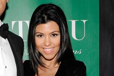 Kourtney Kardashian partied at the Chateau Nightclub & Gardens at the Paris Las Vegas. With her glossy hair and those fluttering lashes, it may not be new ground but it's a look that works. Loving the winged eyeliner too!