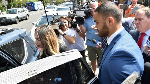 Walker and his fiancee hurried into a waiting car after the NRL star pleaded not guilty to two charges of domestic violence related assault.