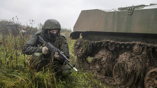 A Russian soldier takes cover during last year's war games.