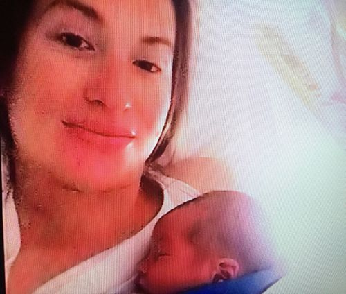 Vikki Campion holding son Sebastian