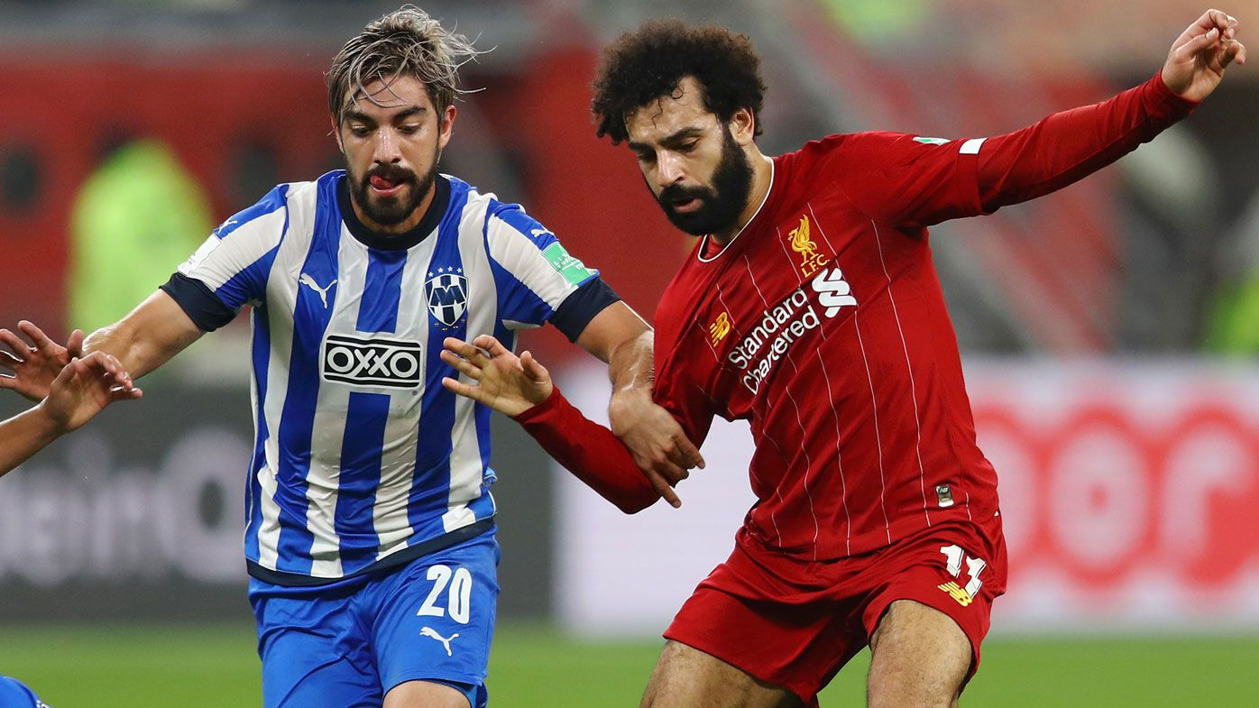 Mohamed Salah of Liverpool battles for possession with Carlos Rodriguez and Rodolfo Pizarro of C.F. Monterrey during the FIFA Club World Cup semi-final