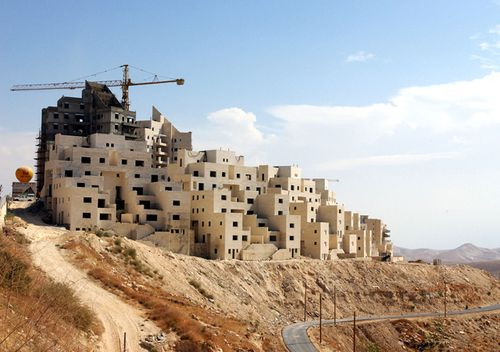 New houses are seen under construction in October 2003 in the Jewish settlement of Ma'ale Adumim, West Bank