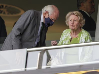 Former Prime Minister John Howard and his wife Janette, prepare to watch play after a rain delay on day one of the third cricket test between India and Australia at the Sydney Cricket Ground, Sydney, Australia, January 7, 2021.