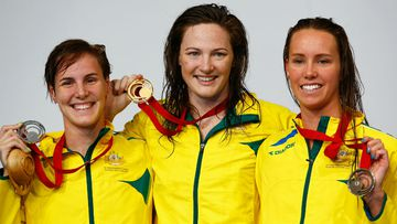Gold medallist Cate Campbell (centre) with her sister Bronte Campbell, on the podium with fellow Aussie and bronze medallist Emma McKeon following their victory in the women's 100m freestyle final. (Getty Images)