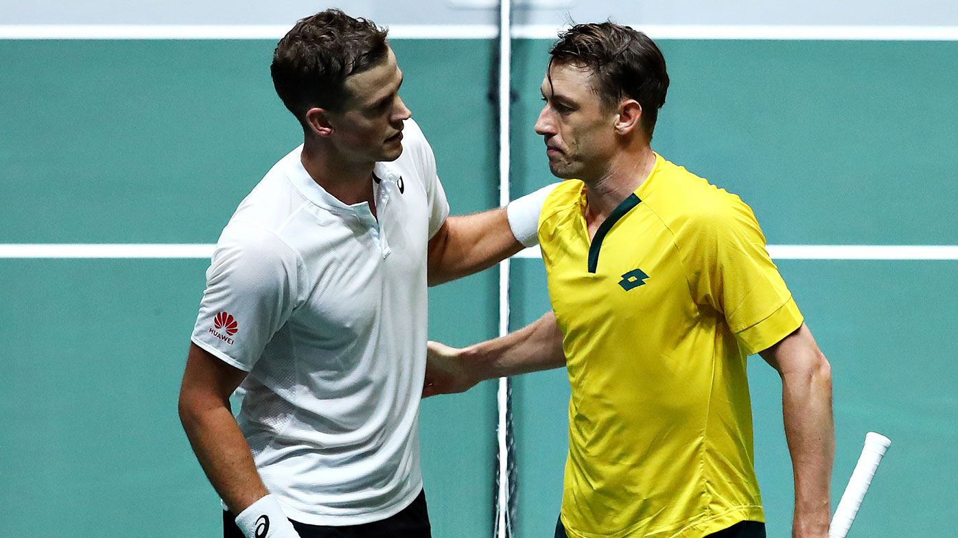 Vasek Pospisil of Canada shakes hands with John Millman of Australia after their quarter final singles match