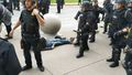 Elderly man knocked out by US riot police