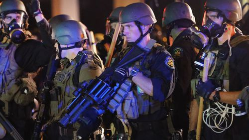 Police in Ferguson armed with tear gas grenade launchers. (Getty)