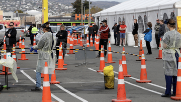 FILE - In this April 17, 2020, file photo, shoppers line up at a pop-up community COVID-19 testing station at a supermarket carpark in Christchurch, New Zealand. (AP Photo/Mark Baker,File)