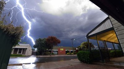 This photo shows lightning strike a metal chimney on a factory roof in Ridleyton, Adelaide. (David Stevenson)