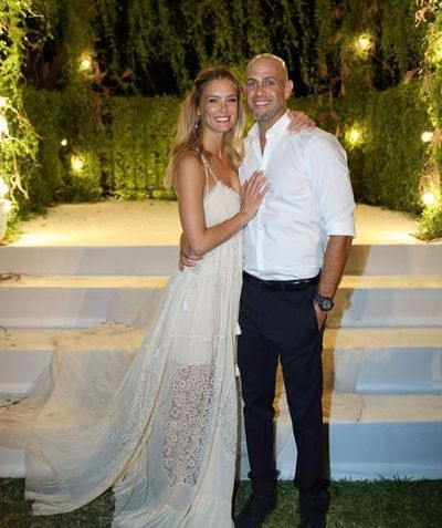 <p>Bar Refaeli and Adi Ezra, 2015</p> <p>The bride wore -Chloé</p>
