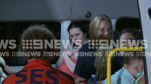 Some of the tourists rescued from the Big4 Caravan Park in Cairns in the middle of the night. Picture: 9NEWS