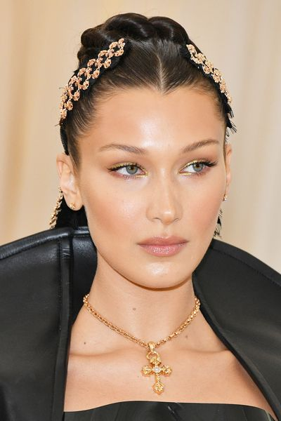 <p>To accessorise her black Goth Princess-inspired gown created by Chrome Hearts, Hadid went for a beauty look that was  sleek, sexy and utterly captivating. You may not have an occasion to channel her high-voltage <em>Zena Warrior Princess</em> look but you can replicate her luminous glow, nude lips and glittery gold eye.</p>
