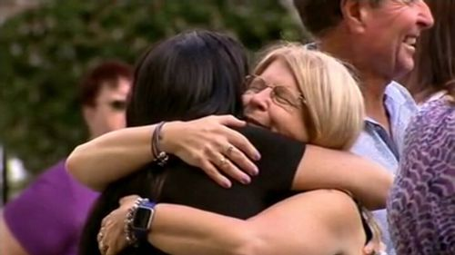 Faye Leveson embraces a mourner at Matthew's funeral.