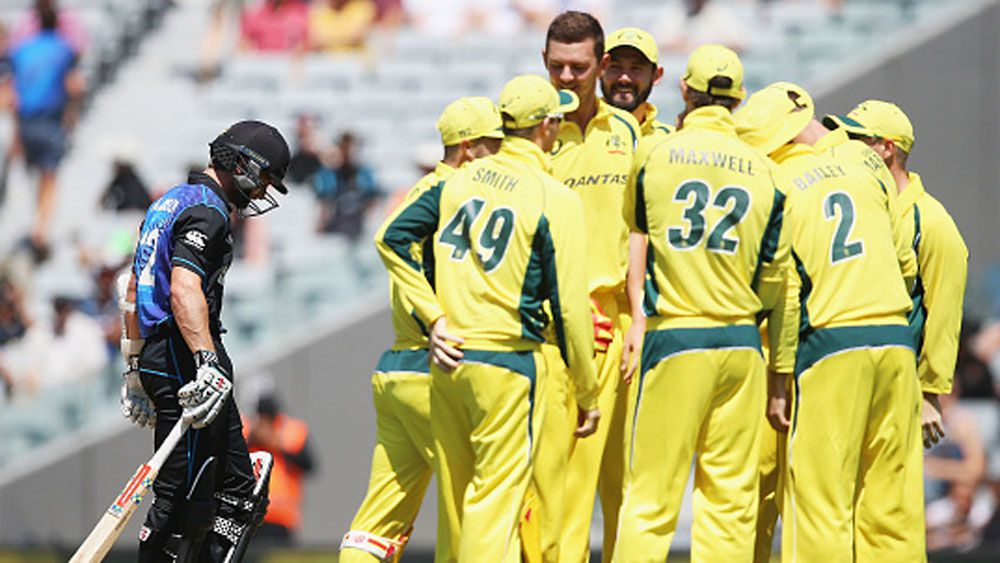 Australian players celebrate the wicket of Kane Williamson. (Getty)