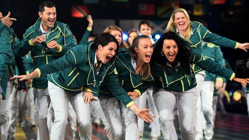 Australian athletes smile as they arrive during the Opening Ceremony for the Glasgow 2014 Commonwealth Games at Celtic Park. (Getty Images)