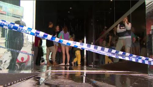 Terrified guests were forced to walk down flooded stairwells in the Melbourne CBD hotel building last night. Picture: 9NEWS