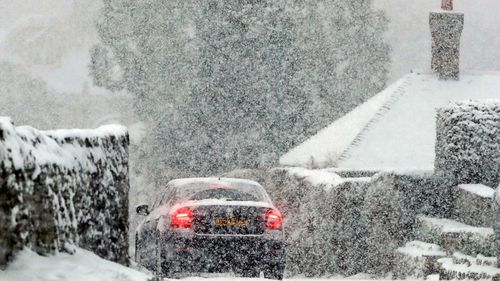 Blizzard-like conditions fall over Kent in southern England. (AP).