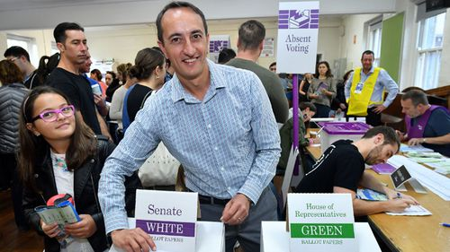 Dave Sharma casts his vote as he fights for the seat of Wentworth.