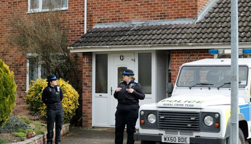 Police stand guard outside Mr Skripal's home. (AAP)