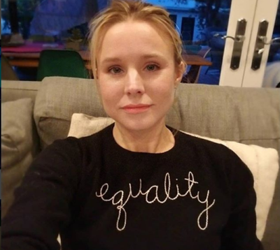 <em>Actress Kristen Bell proudly showing off her Lingua Franca sweatshirt, $485.70</em>