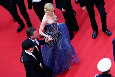 Nic gathers the skirt of her Armani dress to brave Cannes' famous steps.