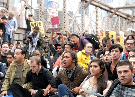 arms linked on New York's Brooklyn Bridge before police began making arrests during a march by Occupy Wall Street. (AAP)
