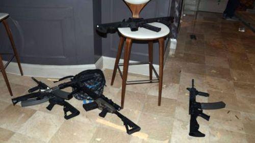 A mound of guns were found inside his Las Vegas hotel room.