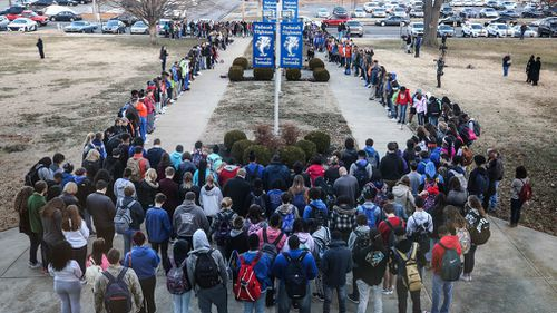 Paducah Tilghman High School held a prayer circle for victims of the Marshall County High School shooting. (AAP)