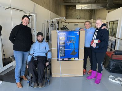 Molly (far right) with her physiotherapist Ryan Medley (second from left) who is a quadriplegic.